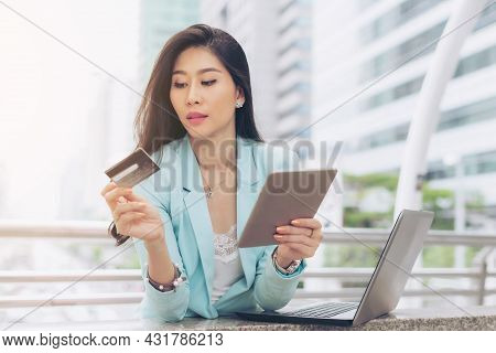 Business Young Woman Company Employee Holding Tablet Phone Computer And Credit Card Uses A Credit Ca