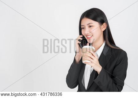 Beautiful Asian Business Woman Using Mobile Telephone And Holding Hot Coffee Cup Isolated On White B