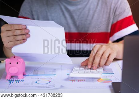Accountant Man Calculate The Bill, Statistic Paper, Earnings Report, Tax At Workplace Office. Busine