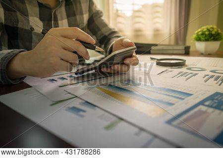 Businessman Accountant Using Calculator At The Office And Financial Data Analyzing Counting On Wood