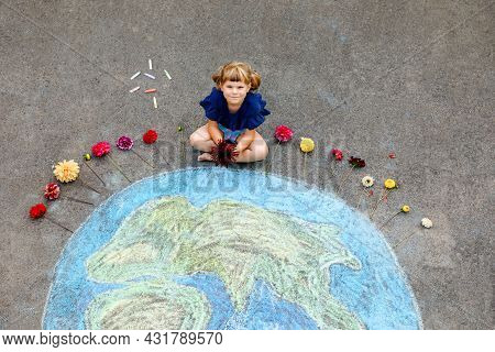 Little Preschool Girl With Flowers And Earth Globe Painting With Colorful Chalks On Ground. Positive