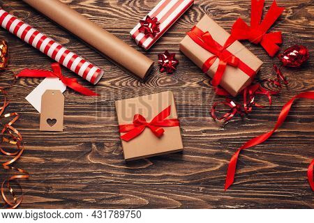 Gift Wrapping For Christmas And New Year. Christmas Background With Gift Boxes, Ropes, Paper Handleb