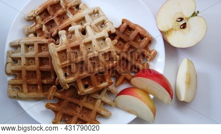 Homemade Square Waffles With Red Apple Slices On White Plate Upper Angle View, Homemade Breakfast Or