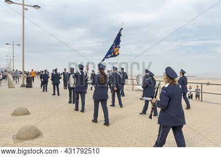 Middelkerke,  West Flanders, Belgium. 27-06-2021.  The Brass Band Is Walking Down The Street