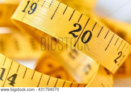 Yellow Color Centimeter With Black Figures For Measurement Of Length And Width On A White Background