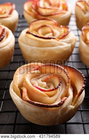 Cooling Rack With Freshly Baked Apple Roses On Grey Table, Closeup. Beautiful Dessert