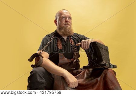Comic Portrait Of Muscular Bearded Bald Man, Blacksmith In Leather Apron Or Uniform Isolated On Yell