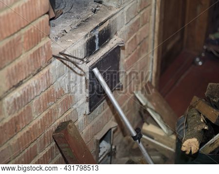 An Oven Door Propped Up With A Metal Stick To Prevent Fire, Shallow Dof