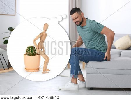 Hemorrhoid Problem. Man Suffering From Pain In Living Room