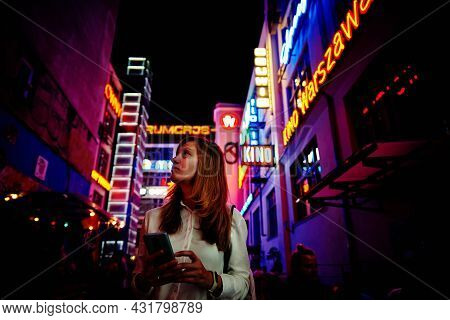 Woman Portrait At Night City. Ruska Street With Neon Lights In Night City. Wroclaw, Poland - August