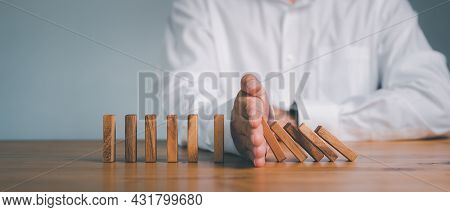 Risk And Strategy In Business, Hand Stopping Wooden Block Domino Business Crisis Effect Or Risk Prot