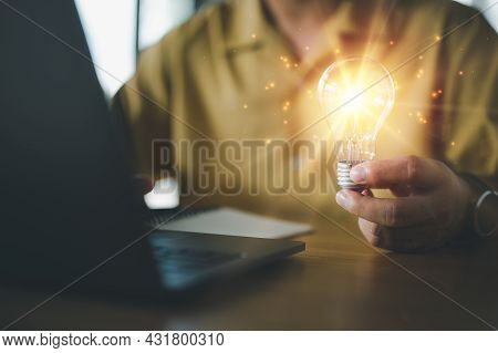 Innovation. Hands Holding Light Bulb For Concept New Idea Concept With Innovation And Inspiration, I