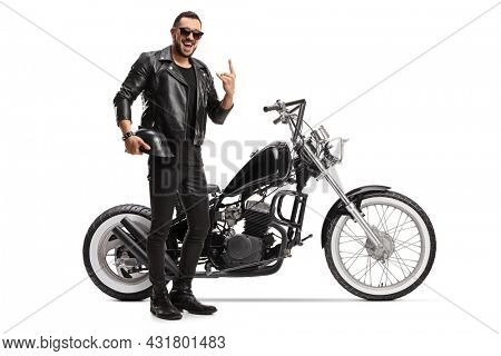 Cool biker with a chopper holding helmet and gesturing rock and roll sign isolated on white background
