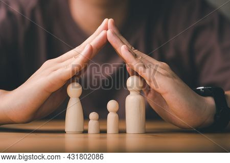 Protecting Hands Over Wooden Family, Family Protection And Care Concept, Family Home, Foster Care, H