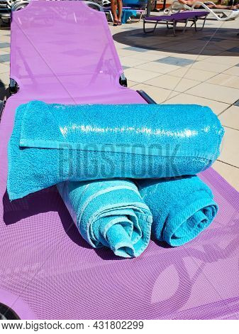 Close-up Of Bright Blue Towels On A Chaise Longue Wrapped In Stretch Film, Security Measures Against