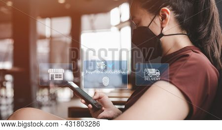 Online Shopping And Mobile Business Concept, Asian Woman Ware Cloth Face Mask Using Smart Phone For