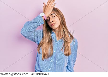 Beautiful hispanic woman wearing casual shirt surprised with hand on head for mistake, remember error. forgot, bad memory concept.