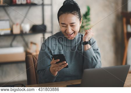 Excited Happy Asian Woman Looking At Phone Screen, Celebrating Online Win, Overjoyed Young Female Sc