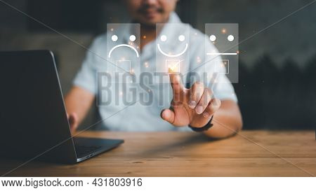 Customer Service Evaluation Concept. Businessman Pressing Face Smile Emoticon Show On Virtual Screen
