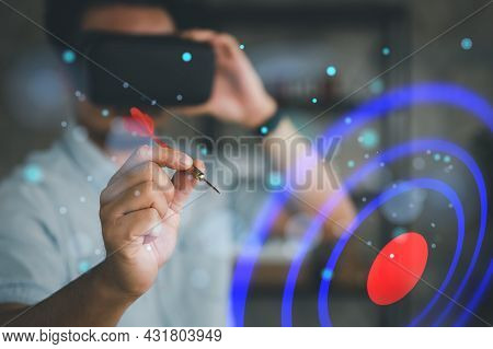 Man Wearing Vr Glasses And Throwing Red Arrow Dart To Virtual Target Dart Board. Setup Objectives An
