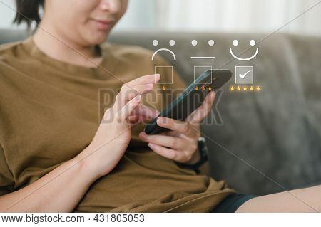 Customer Service Evaluation Concept. Smart Women Use Smartphone Choosing Face Smile Emoticon. Survey