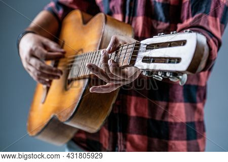 Guitars And Strings. Man Playing Guitar, Holding An Acoustic Guitar In His Hands. Music Concept. Gui