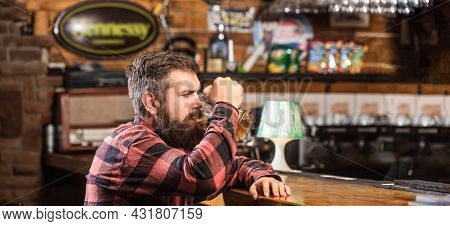 Man Drinks Beers At The Bar Counter. People, Lifestyle, Recreation. Man With Beer. Bearded Hipster H
