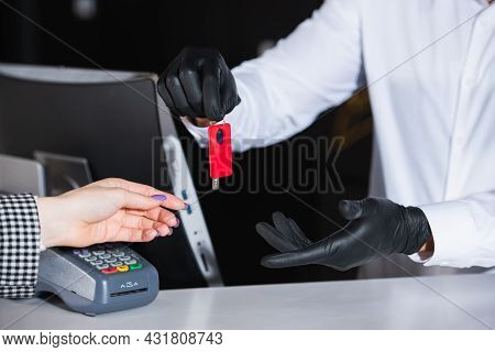 Cropped View Of Receptionist In Latex Gloves Giving Room Key To Guest