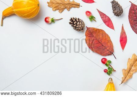 Autumn Mockup. Autumn Pattern Of Autumn Leaves, Cones, Cotton, Pumpkin, Red Berries Background On Wh