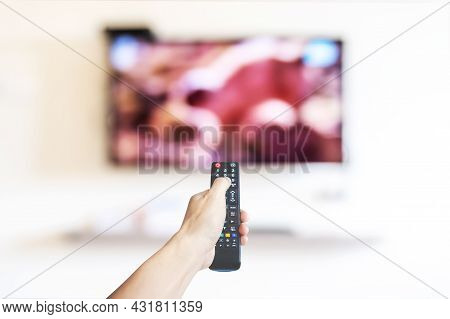 Hand Holding Television And Audio Multimedia Remote Control For Watching Tv