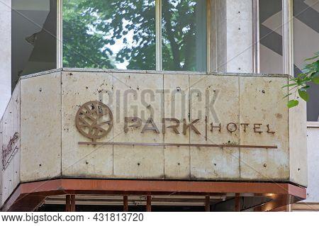 Belgrade, Serbia - June 11, 2021: Abandoned Building Recession Park Hotel Sign Ruin.