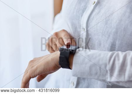 Close Up Shot Of Faceless Woman In White Clothing Girl Using Her Her Smartwatch, Touching Touch Scre