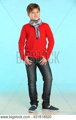 A Trendy And Friendly Teenage Boy Wearing A Red Sweater And A Plaid Scarf. He Stands Tall With His H