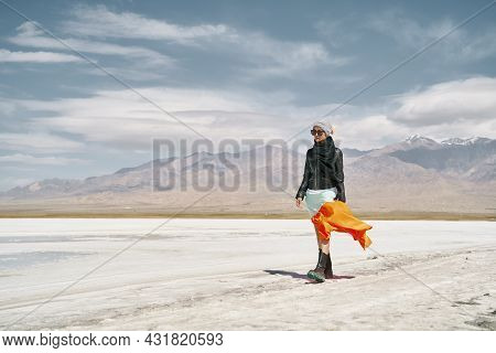 Asian Woman Female Tourist In Long Skirt Walking On Saline Alkali Land