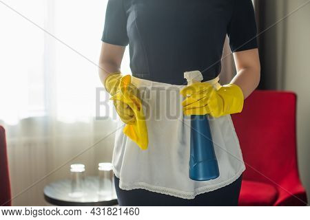 Cropped View Of Young Maid In Rubber Gloves Holding Spray Bottle And Rag