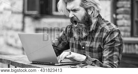 Living In Digital Age. Angry Man Sitting In Cafe With Laptop And Checking Email. Freelancer Man Work