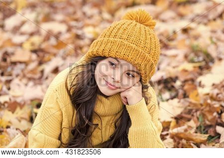 Warm Autumn Mood. Small Child In Good Mood Outdoors. Little Child Relax On Fresh Air On Autumn Day.