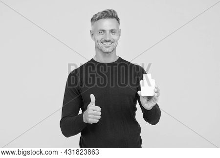 Happy Caucasian Man With Unshaven Facial Hair In Casual Style Show Thumbs Ups Hand Gesture Holding M