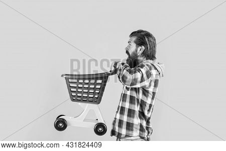 Riding A Shopping Cart. Funny Man With Small Shopping Cart. Weekend On Buying Products. Rejoices Suc