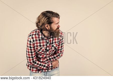 Pain Relievers. Man Feeling Hoove. Male Health Care. Pain In Stomach. Mature Hipster With Beard Has