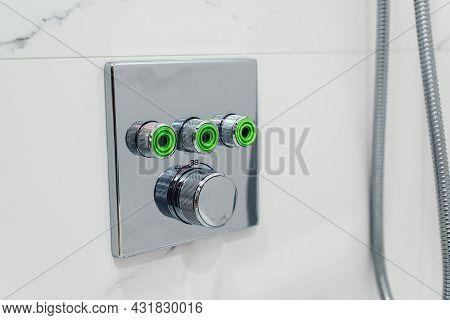 Shower Switch On Bathroom Wall. Bathroom Shower, Equipment. New Metal Shower Switch.