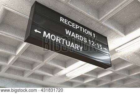 A Hospital Directional Sign Mounted On A Cast Concrete Ceiling Highlighting The Way Towards The Mort