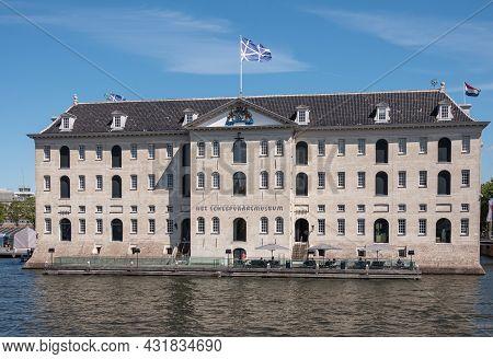 Amsterdam, Netherlands - August 15, 2021: Beige Stone Square Massive Maritime Or Scheepvaart Museum