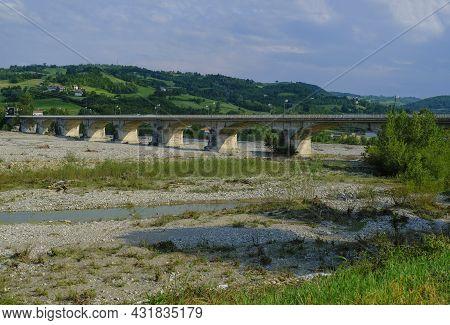 Bridge Over The Mountains River Torrente Parma In Summer Across Green Hills. Langhirano, Emilia-roma