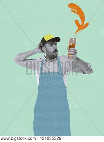 Young Man, Waiter, Ale Brewer Holding Beer Glass With Lager Isolated On Light Background. Contempora