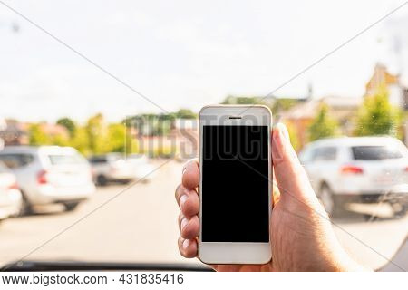 Man Using Phone In Car, Gps Navigation ,blank Space Frame On Smartphone In Hand With Blur Image Of T