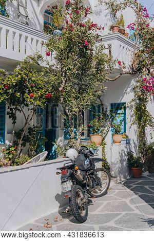 Mykonos Town, Greece - September 24, 2019: Motorbike Parked In Front Of A Traditional Whitewashed Ho