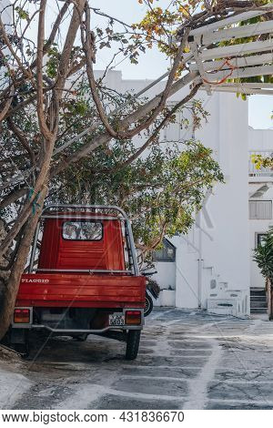 Mykonos Town, Greece - September 24, 2019: Rear View Of A Red Piaggio Ape Car Parked On A Street In
