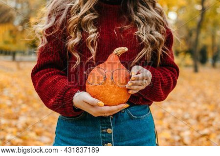 Faceless Portrait Of Woman Holding Orange Halloween Pumpkin On Autumn Park Yellow Trees Background.