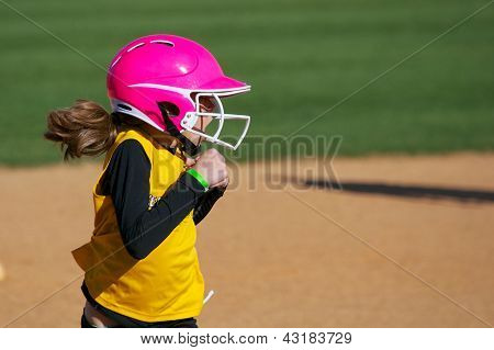 Softball Player Running with Surprised Look on Her Face